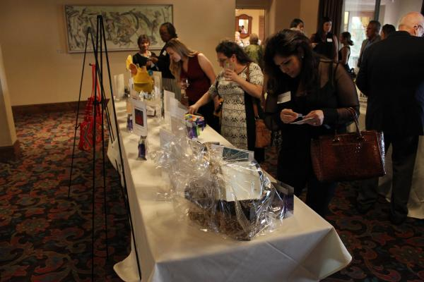 attendees peruse raffle items at annual dinner